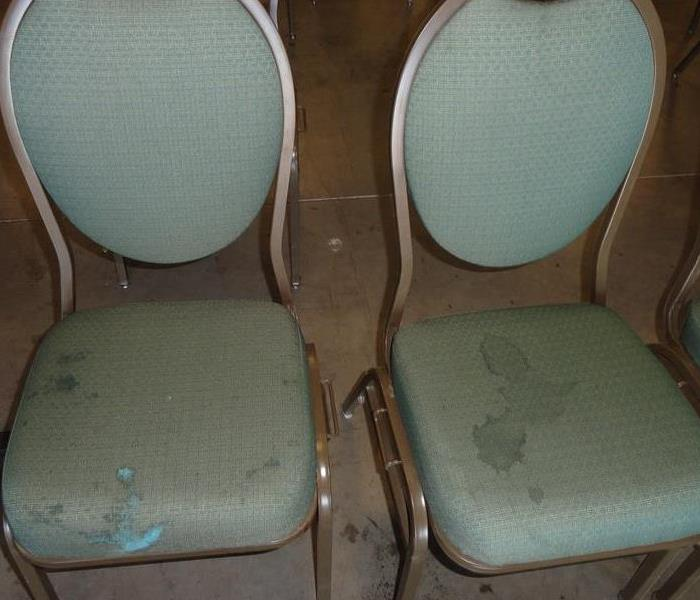 Stained chairs with food and drinks that were spilled