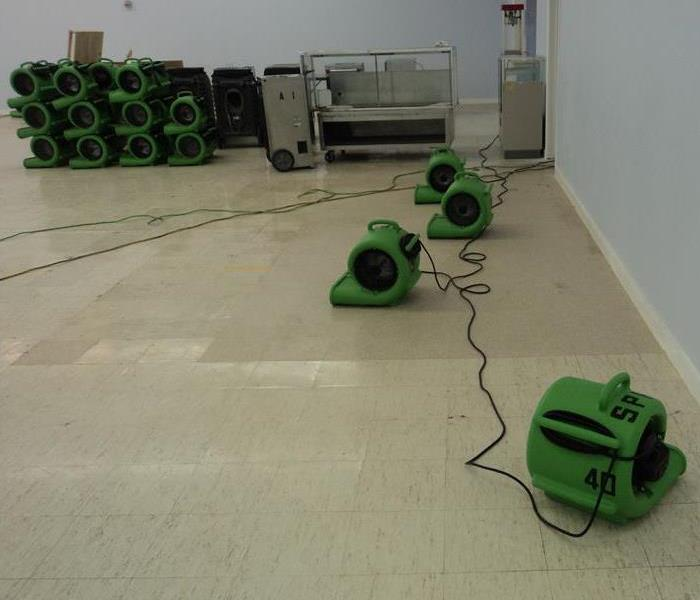 Floors being dried by SERVPRO equipment