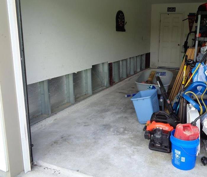 garage wall with flood cut in drywall